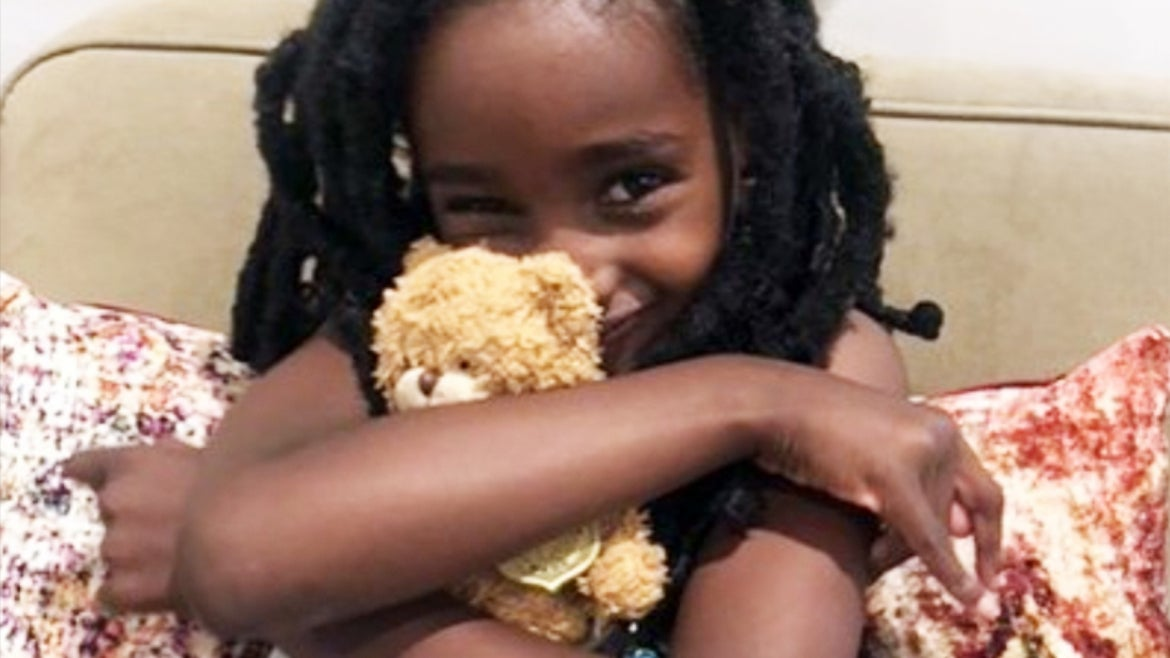 Naomi Pascal holds her teddy bear after they were reunited.