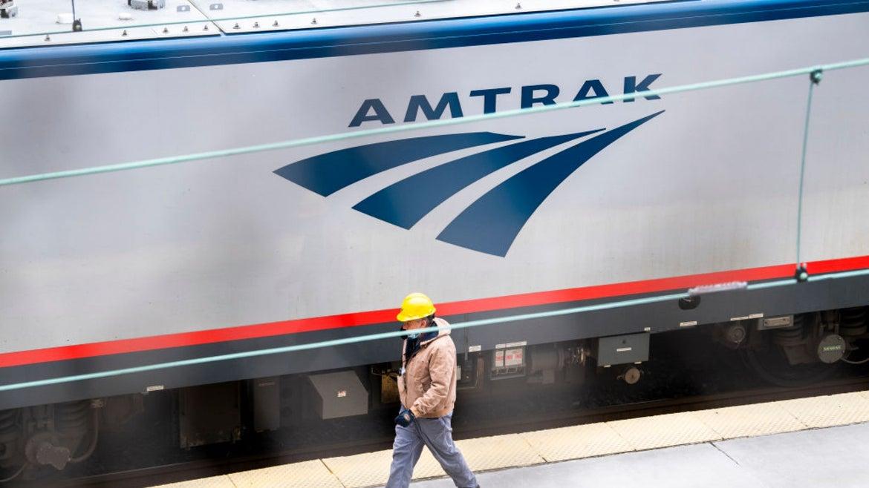 Amtrak train with staff walking beside