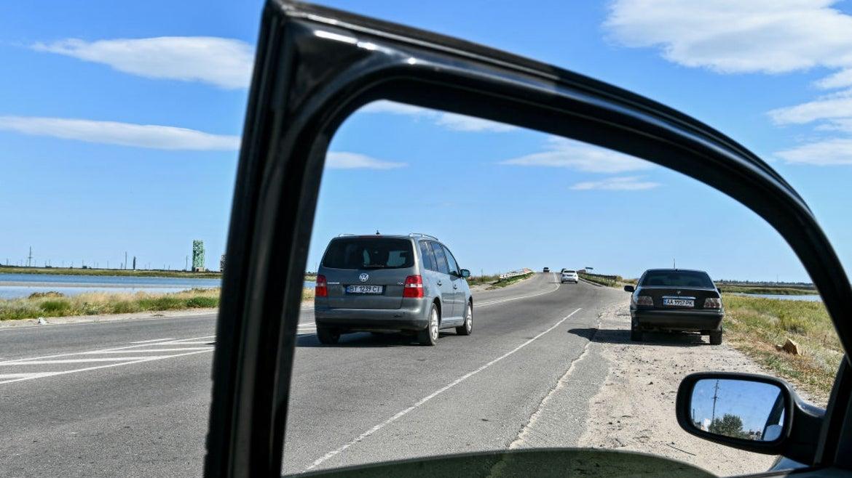 Open car door with window down
