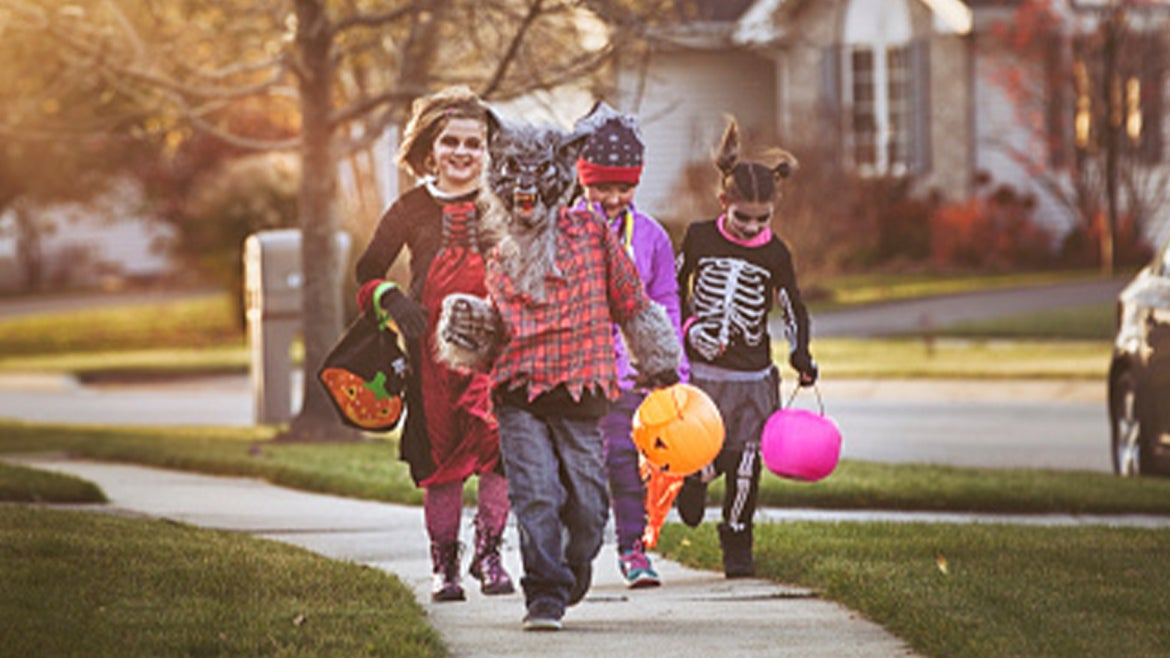 A stock image of children trick-or-treating.