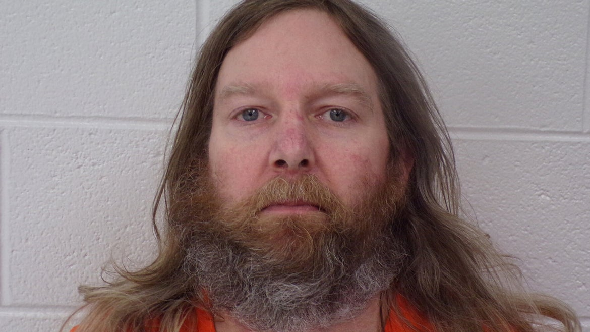Jeffrey Burnham, 46, is charged with killing 3 people, including his pharmacist brother.