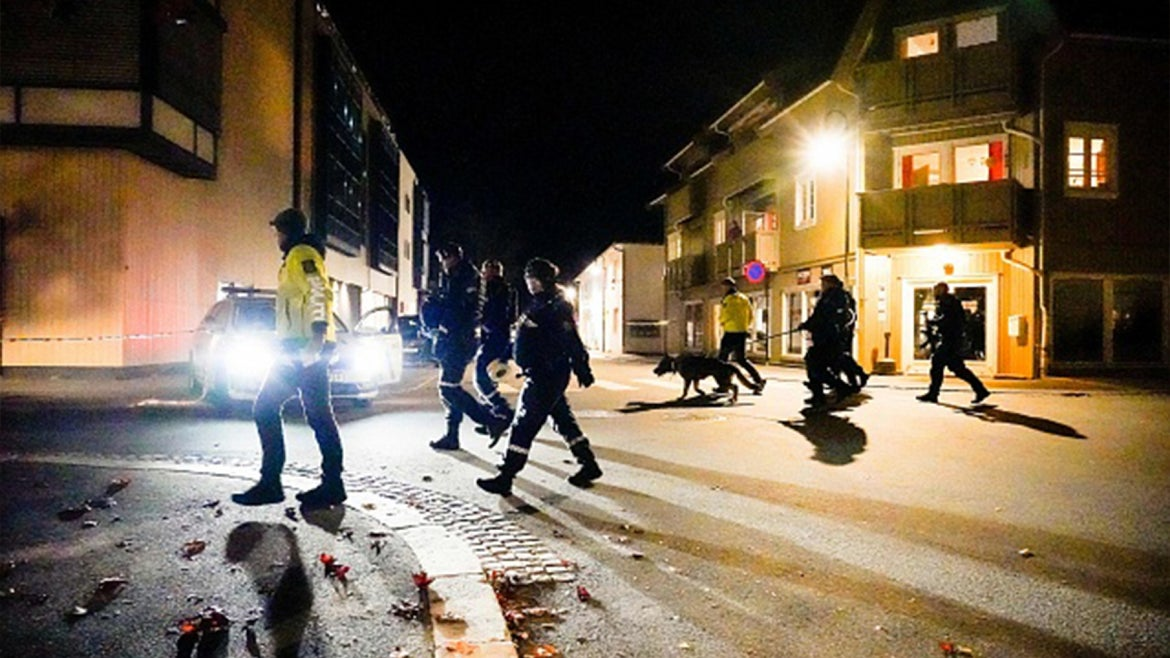 Police officers cordon off the scene where they are investigating in Kongsberg, Norway after a man armed with bow killed several people before he wasarrested by police on October 13, 2021.